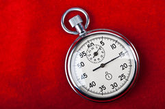 Retro stopwatch. On a red background Stock Images