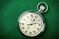 Retro stopwatch. On a green background Stock Images