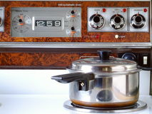 Retro Stove Top. Detail of the control panel (with fake wood veneer) and the hob of an electric cooker from circa 1980 Royalty Free Stock Photography