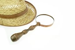 Retro Straw Hat and  magnifying glass Stock Photography