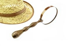 Retro Straw Hat and  magnifying glass Stock Photos