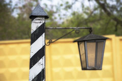 Retro Street Flashlight. Retro lantern street against a background of green vegetation Stock Photo