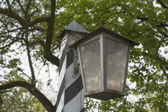 Retro Street Flashlight. Retro lantern street against a background of green vegetation Stock Images