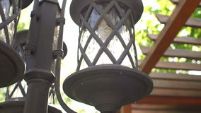 Retro street lamp close-up on background sunlight. Retro Street lamp close-up on a background of tree and wooden stairs stock footage