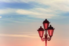 Retro street lamp on the embankment of the river stock image