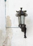 Retro street lantern on peeling plaster wall Royalty Free Stock Photography