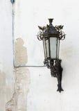 Retro street lantern on peeling plaster wall. Retro street lantern on white peeling plaster wall Royalty Free Stock Photography