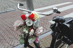 Retro bike with bridal bouquet of flowers, Utrecht, Netherlands Royalty Free Stock Photo