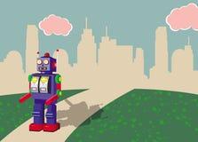Retro stuk speelgoed robot die in een retro landschap loopt Stock Afbeeldingen