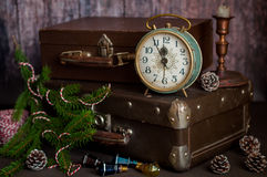 Retro Style Alarm Clock and Suitcases. Vintage Retro Style Alarm Clock and Old Fashioned Suitcases, Five Minutes to Midnight, copy space for your text Stock Photos