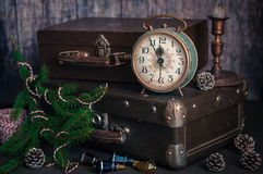 Retro Style Alarm Clock and Suitcases. Vintage Retro Style Alarm Clock and Old Fashioned Suitcases, Five Minutes to Midnight, copy space for your text Stock Photo