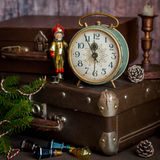 Retro Style Alarm Clock and Suitcases. Vintage Retro Style Alarm Clock and Old Fashioned Suitcases, Five Minutes to Midnight, square Stock Image