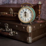 Retro Style Alarm Clock and Suitcases. Vintage Retro Style Alarm Clock and Old Fashioned Suitcases, Five Minutes to Midnight, square Royalty Free Stock Photos