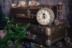 Retro Style Alarm Clock and Suitcases. Vintage Retro Style Alarm Clock and Old Fashioned Suitcases, Five Minutes to Midnight, copy space for your text Royalty Free Stock Images