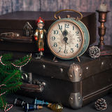 Retro Style Alarm Clock and Suitcases. Vintage Retro Style Alarm Clock and Old Fashioned Suitcases, Five Minutes to Midnight, square Stock Photo