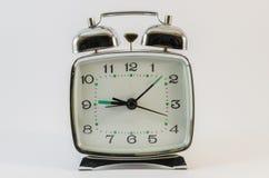 Retro style alarm clock. On the white background Stock Photo