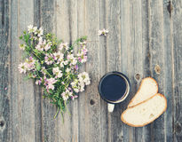Retro style background. Vintage coffee mug with bread on weather Stock Images