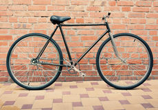 Retro style bicycle against brick wall, vintage tinted photo.  Royalty Free Stock Photo
