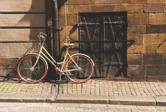 A retro style bicycle changed to a pole, in the old townGamla Stan of Stockholm, Sweden. Circa July 2016 Royalty Free Stock Photos