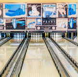 Retro style bowling alley with old-time adds. KFAR SABA, ISRAEL - DEC. 12, 2015: A retro style bowling alley near Tel Aviv, Israel featuring old-time bowling royalty free stock images