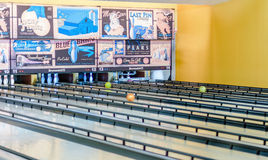 Retro style bowling alley with old-time adds. KFAR SABA, ISRAEL - DEC. 12, 2015: A retro style bowling alley near Tel Aviv, Israel featuring old-time bowling stock photos