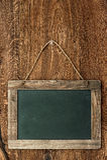 Retro style chalkboard on wooden wall Stock Photo