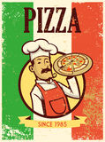 Retro style chef presenting a plate of pizza Royalty Free Stock Photos