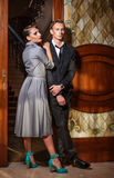 Retro style couple at the door Stock Photos
