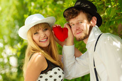 Retro style couple in love with red heart Stock Photography