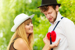 Retro style couple in love with red heart Stock Images