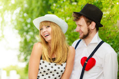 Retro style couple in love with red heart Stock Photo