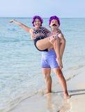 Retro style couple on the seashore Royalty Free Stock Photos
