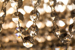 Retro style crystal chandelier. transparent pendant macro view. light background soft focus. Royalty Free Stock Images