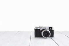 Retro style digital camera on wooden background Stock Photo