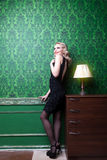Retro style dress woman in vintage green room Stock Photography