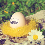 Retro style Easter egg with mustache Stock Image