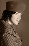 Retro-style fashion woman. Retro styled female portrait in sepia royalty free stock images