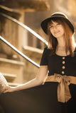 Retro style fashion woman in old town Royalty Free Stock Image