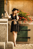 Retro style fashion woman in old town Royalty Free Stock Photography