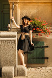 Retro style fashion woman in old town Stock Images