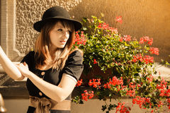 Retro style fashion woman in old town Stock Photography