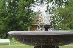 Retro style fountain closeup with water splashes Stock Image