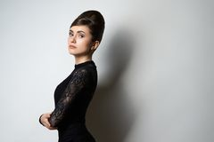 Retro style girl in black clothes on white Royalty Free Stock Images