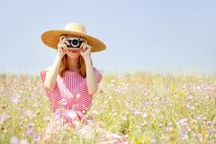 Retro style girl at countryside Stock Photography