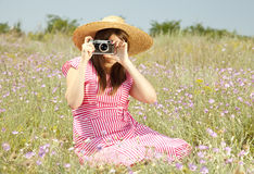 Retro style girl at countryside with camera Royalty Free Stock Images