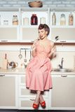 Retro style girl in the kitchen. Stock Photography