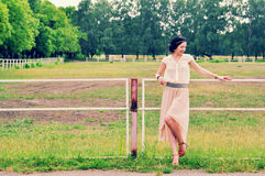 Retro style girl at paddock meadow Stock Image