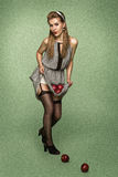 Retro style girl in stockings injuring apples Stock Photos