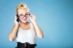 Retro style. Happy girl talking phone Stock Images