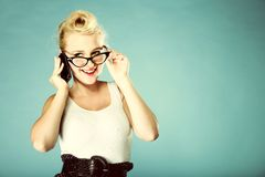Retro style. Happy girl talking phone Royalty Free Stock Image